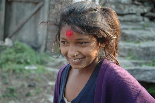 Smilende Gurung pige