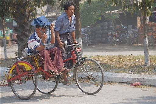 En af Mandalays mange cykeltaxi