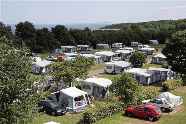 De danske campingpladser ligger oftest i den skønneste natur og de fleste kystnært