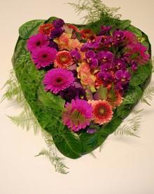 Hjerte i røde og lilla nuancer.