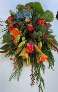 Bårebuket med orange roser