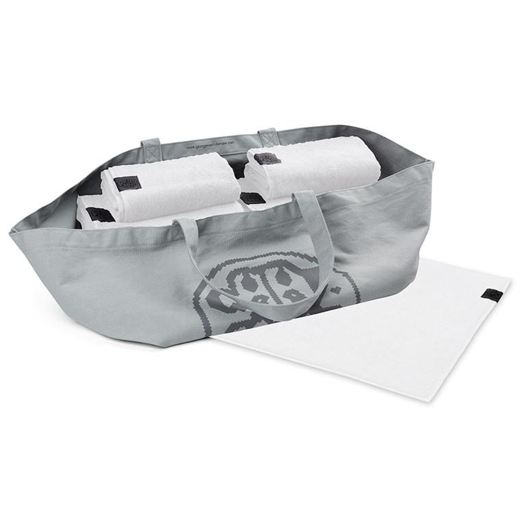 Hvit håndklepakke med bærenett i canvas