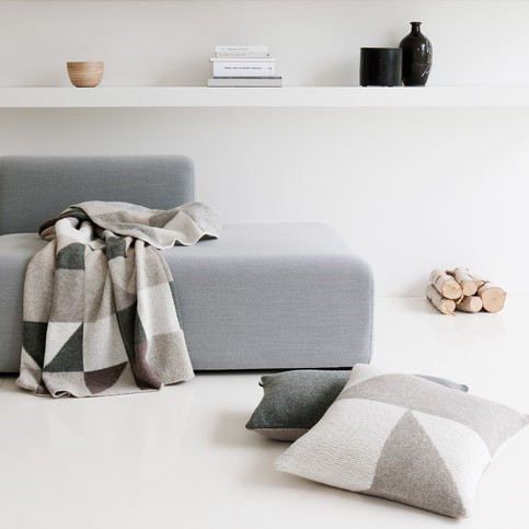 patches boasts a pure nordic look and both the rug and cushions are knitted from 100 wool from. Black Bedroom Furniture Sets. Home Design Ideas
