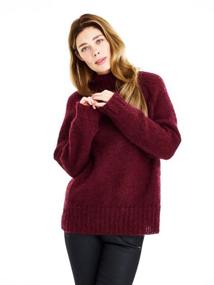 Oversize raglansweater med ribstriber