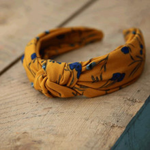 Lé MoshTrine Golden hårbånd i orange